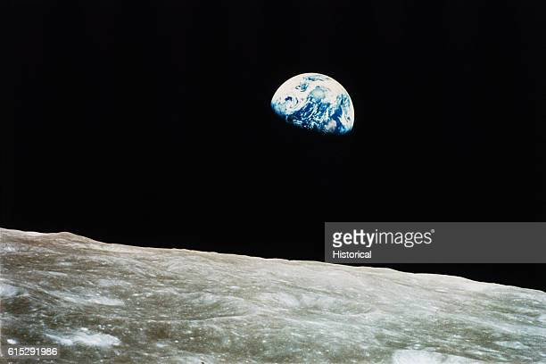 Astronauts saw the Earth rise over the lunar horizon after Apollo 8 came through the lunar orbit insertion burn December 29 1968 | Location Earth and...