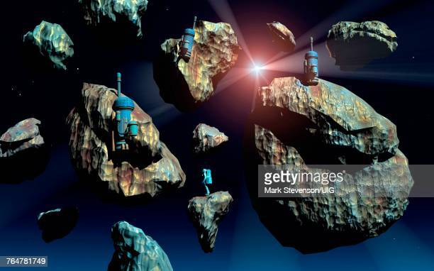 astronauts surveying asteroids. - asteroid stock pictures, royalty-free photos & images