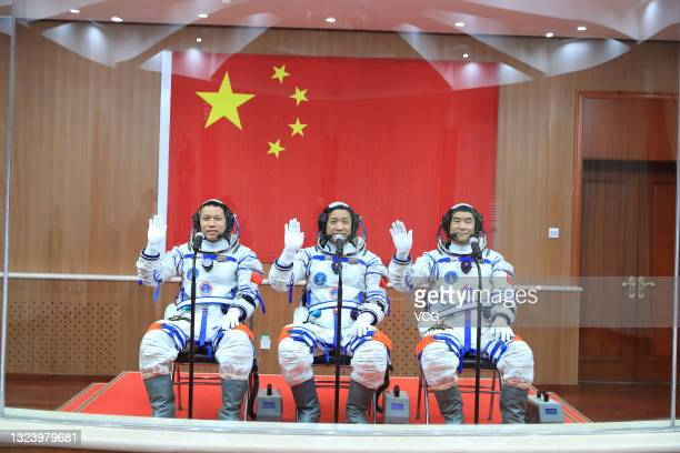 Astronauts Tang Hongbo, Nie Haisheng and Liu Boming attend a see-off ceremony for Chinese astronauts of the Shenzhou-12 manned space mission at...
