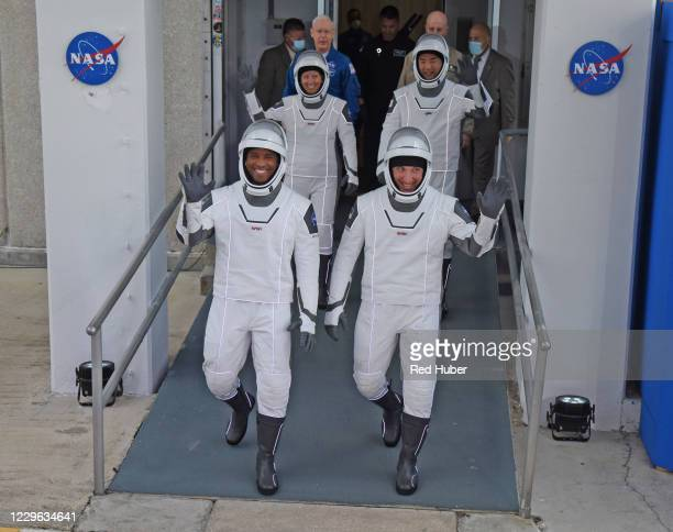 Astronauts, vehicle pilot Victor Glover , commander Mike Hopkins , mission specialist Shannon Walker and mission specialist from the Japan Aerospace...