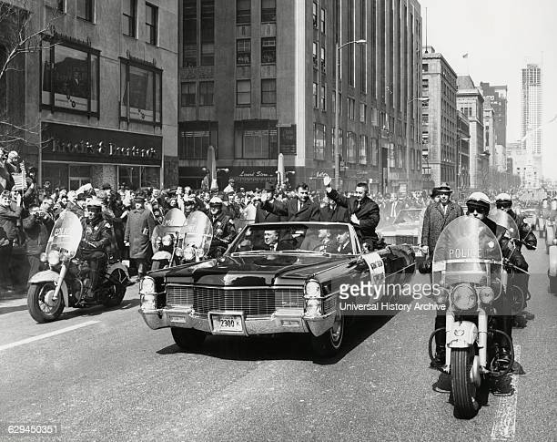 Astronauts Virgil 'Gus' Grissom and John Young Being Greeted by Crowd During Parade on Michigan Avenue after Completion of Gemini 3 Space Mission...