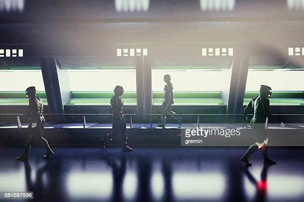 Astronauts walking in alien spaceship corridor