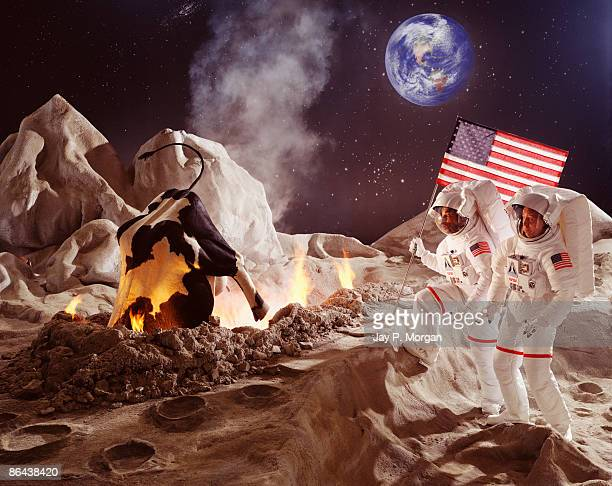 Astronauts with crashed cow on moon