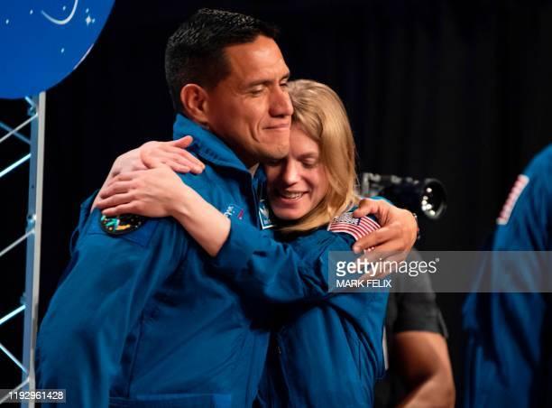 NASA astronauts Zena Cardman and Francisco Rubio hug after during astronaut graduation at Johnson Space Center in Houston Texas on January 10 2020...