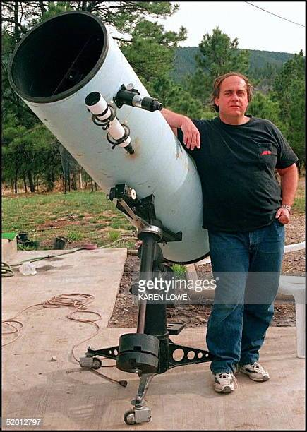 Astronomer Alan Hale poses 03 April next to the telescope that he used to discover the HaleBopp comet Hale along with Thomas Bopp discovered the...