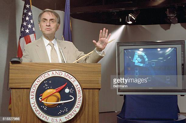 Astronomer Carl Sagan Speaks at a news conference where NASA made available the last pictures taken by Voyager 1 which show the solar system as...