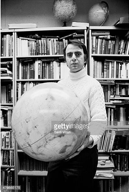 Astronomer Carl Sagan with a clobe on March 20 1974 in Ithaca New York