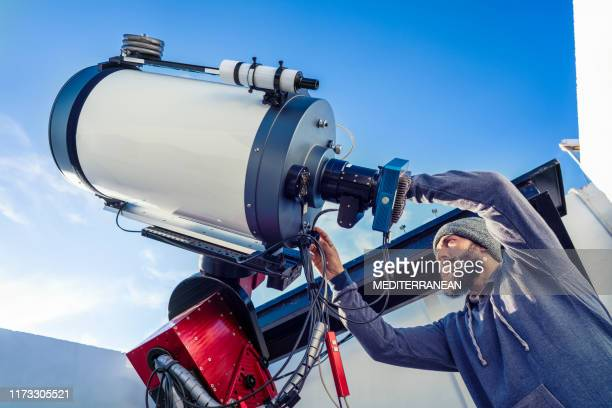 astronomer fix telescope cable in daytime - astrophysics stock pictures, royalty-free photos & images