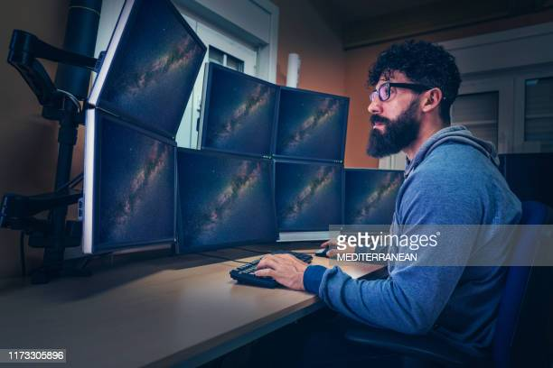 astronomer in control panel room screen - images stock pictures, royalty-free photos & images