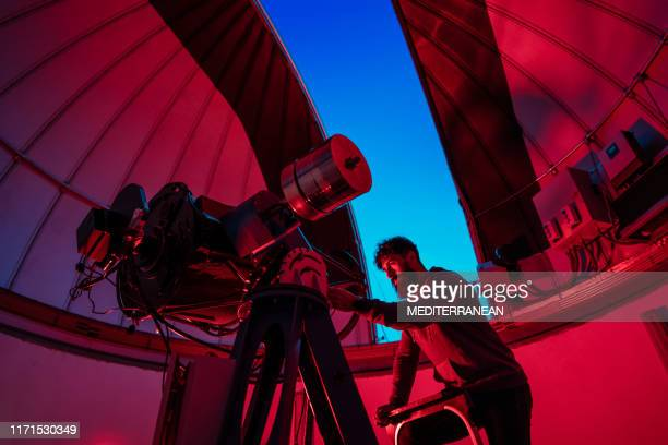 astronomer in photo telescope dome - observatory stock pictures, royalty-free photos & images
