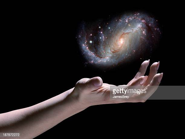 Astronomer; Spiral Galaxy in Hand, Black Background, Science Fiction, God