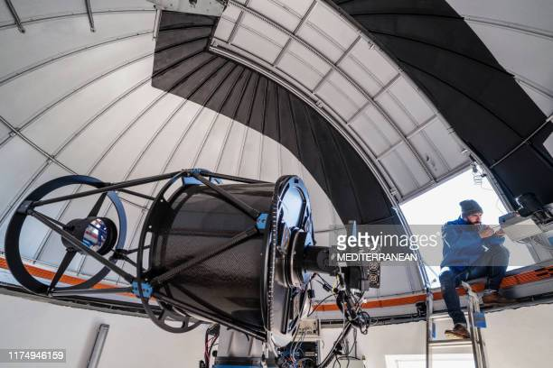 astronomer technician in observatory dome - observatory stock pictures, royalty-free photos & images