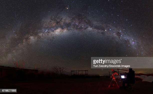 astronomer with a telescope looking at the milky way in the atacama desert, chile. - antofagasta region stock photos and pictures