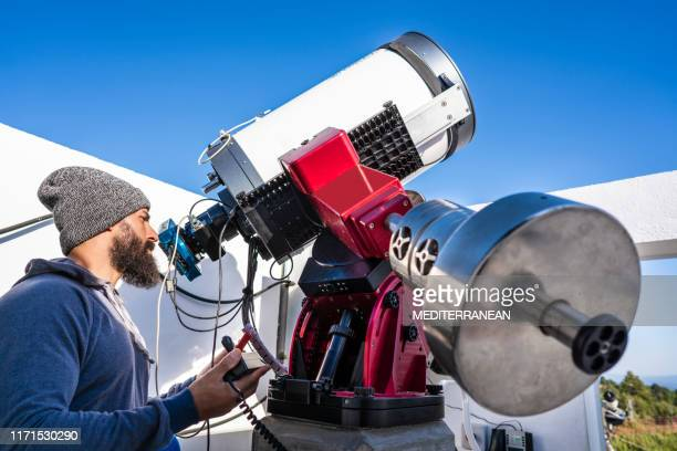 astronomer with photo telescope test - astrophysics stock pictures, royalty-free photos & images