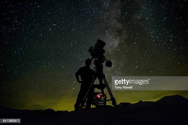 astronomer with telescope milky way - astronomy stock pictures, royalty-free photos & images