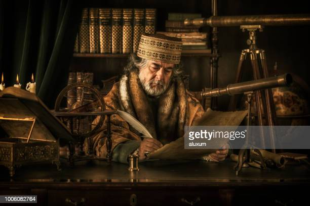 astronomer writing on parchment with feather pen - ancient stock pictures, royalty-free photos & images