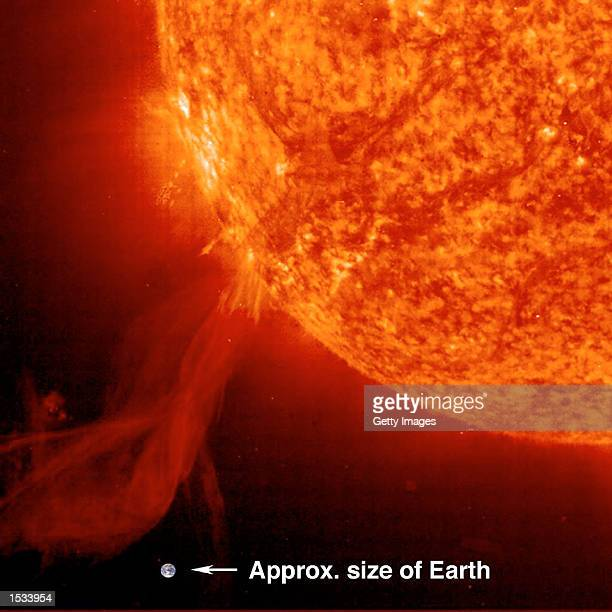 Astronomers at the Solar Heliospheric Observatory captured this image of a solar prominence erupting from the surface of the Sun on October 25 2002...