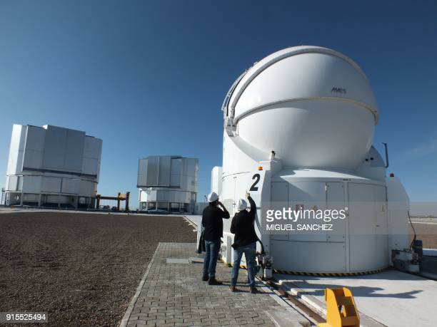 Astronomers check a telescope at the Observatory in Paranal some 1150 km north of Santiago Chile on February 6 2018 With the installation of...