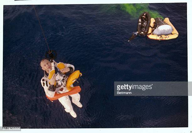 Astronuat Buzz Aldrin is hoisted to recovery helicopter November 15th at conclusion of Gemini12 mission The Gemini12 spacecraft life raft and Navy...