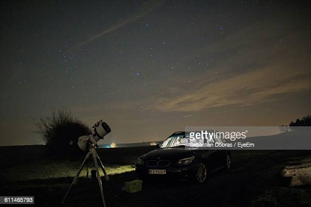 Astrophotography Setup And Car On Landscape Against Night Sky