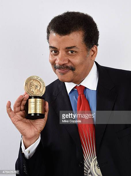 Astrophysicist and host of COSMOS Neil deGrasse Tyson poses with award during The 74th Annual Peabody Awards Ceremony at Cipriani Wall Street on May...