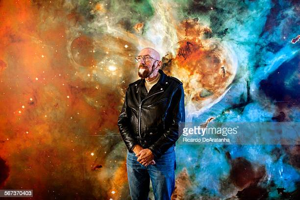 PASADENA CA NOVEMBER 11 2014 Astrophysicist Kip Thorne photograph in front of a stellar mural at California Institute of Technology November 11 in...