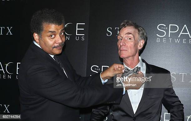 Astrophysicist Neil deGrasse Tyson and educator Bill Nye attend the screening of The Space Between Us hosted by STX Entertainment with The Cinema...