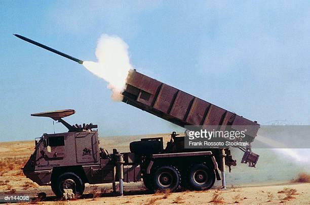 astros 11 ss-30 rocket being launched from truck in desert - raket wapen stockfoto's en -beelden