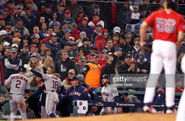 Astros Alex Bregman is welcomed to the dugout after he scored a run in the top of sixth inning off of Red Sox reliever Joe Kelly The Boston Red Sox...