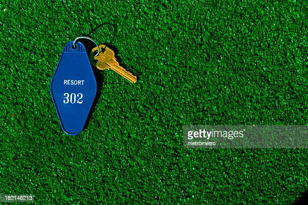 astroturf room key - motel stock photos and pictures