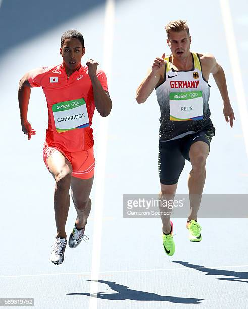 Asuka Cambridge of Japan and Julian Reus of Germany competes in round one of the Men's 100 Meters on Day 8 of the Rio 2016 Olympic Games at the...