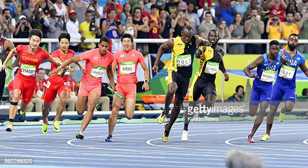 Asuka Cambridge of Japan chases Usain Bolt of Jamaica during the anchor leg of the men's 4x100meter relay final at the Rio de Janeiro Olympics on Aug...