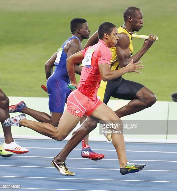 Asuka Cambridge of Japan Usain Bolt of Jamaica and Trayvon Bromell of the United States run the anchor leg of the men's 4x100meter relay final at the...