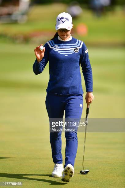Asuka Kashiwabara of Japan acknowledges the gallery on the 16th green during the final round of the Miyagi TV Cup Dunlop Women's Open at Rufu Golf...
