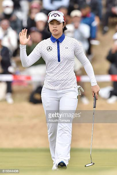 Asuka Kashiwabara of Japan celebrates after making her birdie putt on the 18th green during the final round of the Yokohama Tire PRGR Ladies Cup at...