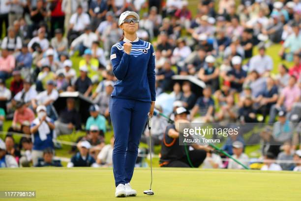 Asuka Kashiwabara of Japan celebrates winning the tournament on the 18th green during the final round of the Miyagi TV Cup Dunlop Women's Open at...