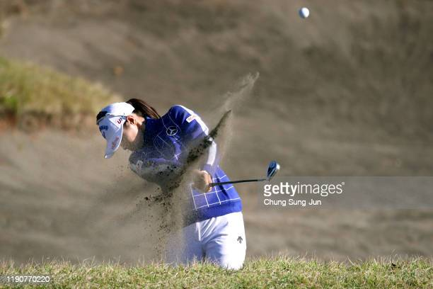Asuka Kashiwabara of Japan hits her second shot from a bunker on the 18th hole during the second round of the LPGA Tour Championship Ricoh Cup at...