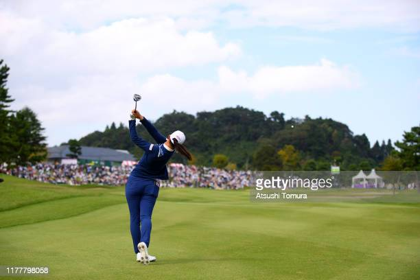 Asuka Kashiwabara of Japan hits her second shot on the 18th green during the final round of the Miyagi TV Cup Dunlop Women's Open at Rufu Golf Club...