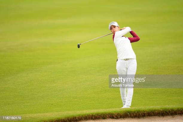 Asuka Kashiwabara of Japan hits her second shot on the 1st hole during the final round of Fujitsu Ladies at Tokyu Seven Hundred Club on October 20...