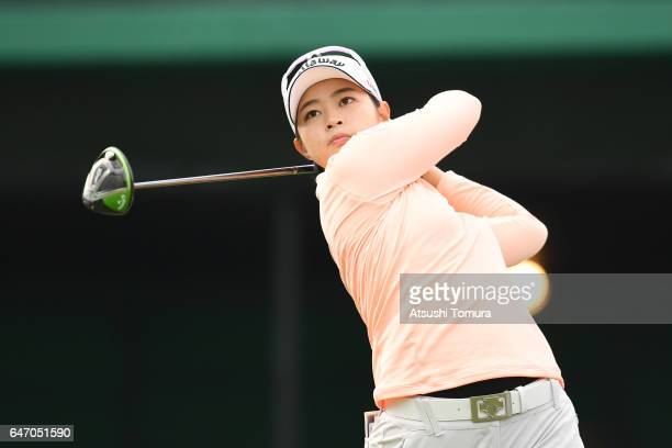 Asuka Kashiwabara of Japan hits her tee shot on the 1st hall during the first round of the Daikin Orchid Ladies Golf Tournament at the Ryukyu Golf...
