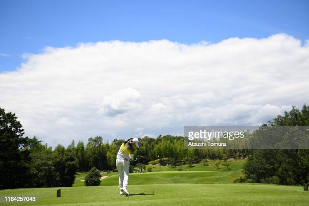 Asuka Kashiwabara of Japan hits her tee shot on the 7th hole during the first round of the Century 21 Ladies Golf Tournament at Ishizaka Golf Club on...