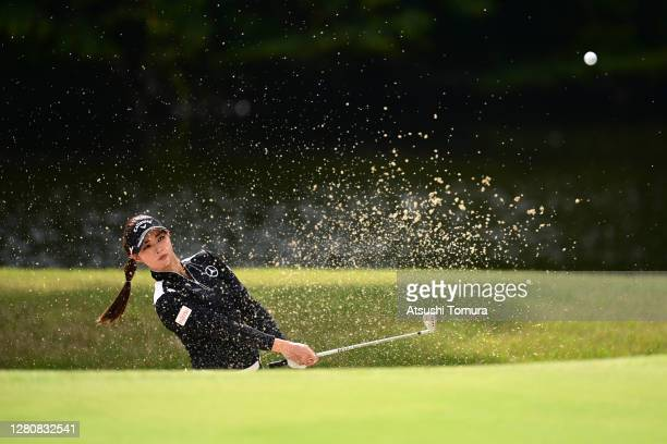Asuka Kashiwabara of Japan hits out from a bunker on the 14th hole during the final round of the Fujitsu Ladies 2020 at the Tokyu Seven Hundred Club...