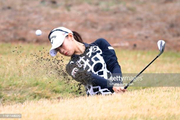Asuka Kashiwabara of Japan hits out from a bunker on the 3rd hole during the final round of the LPGA Tour Championship Ricoh Cup at Miyazaki Country...