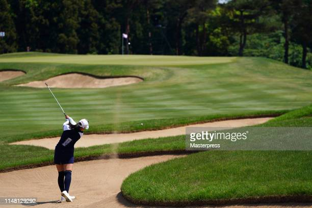 Asuka Kashiwabara of Japan hits out from a bunker on the 5th hole during the second round of the World Ladies Championship Salonpas Cup at Ibaraki...