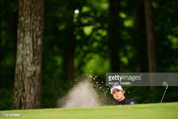 Asuka Kashiwabara of Japan hits out from a bunker on the 9th hole during the first round of the Nippon Ham Ladies Classic at Katsura Golf Club on...