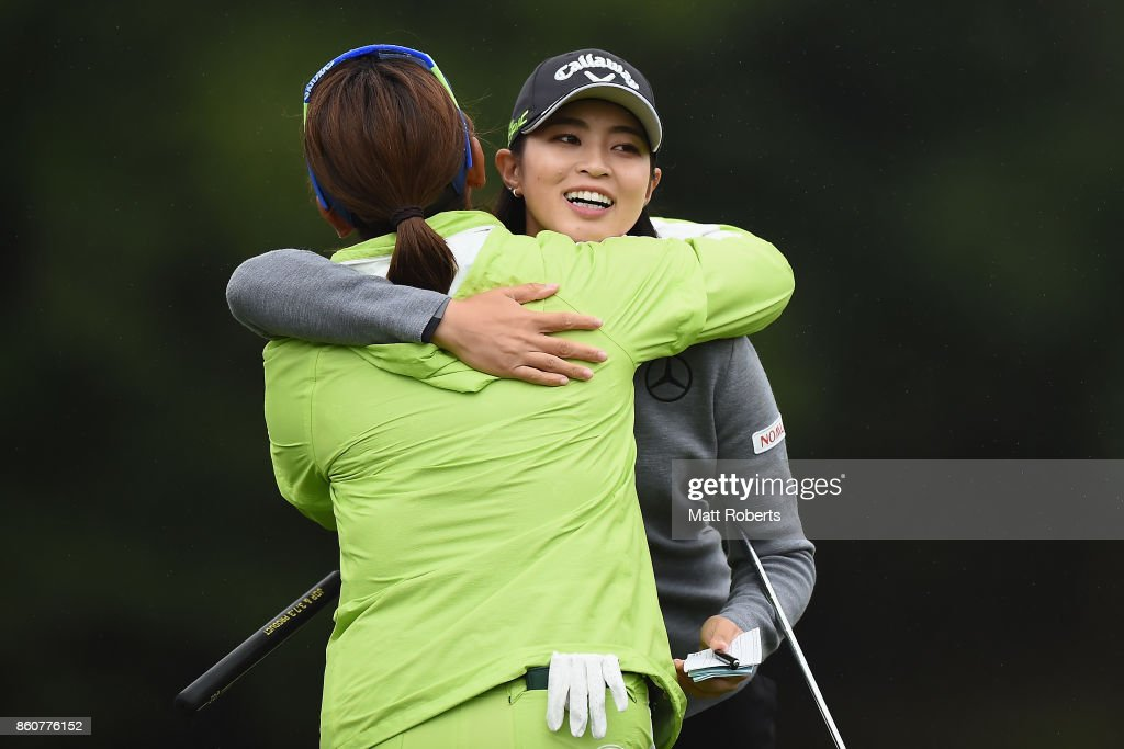Asuka Kashiwabara of Japan hugs Yumiko Yoshida of Japan on the 18th green during the first round of the Fujitsu Ladies 2017 at the Tokyu Seven Hundred Club on October 13, 2017 in Chiba, Japan.