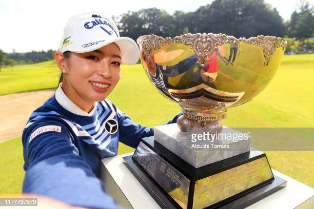 Asuka Kashiwabara of Japan imitates the selfie after winning the tournament following the final round of the Miyagi TV Cup Dunlop Women's Open at...