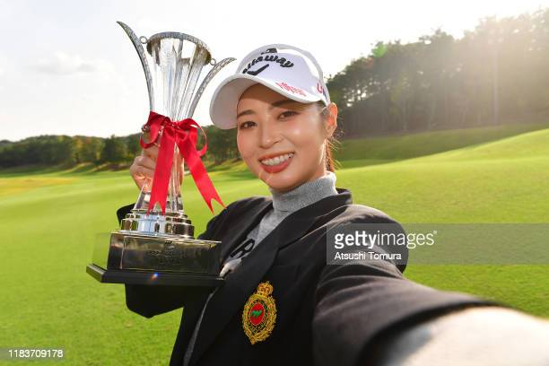 Asuka Kashiwabara of Japan imitates the selfie after winning the tournament following the final round of the Nobuta Group Masters GC Ladies at...