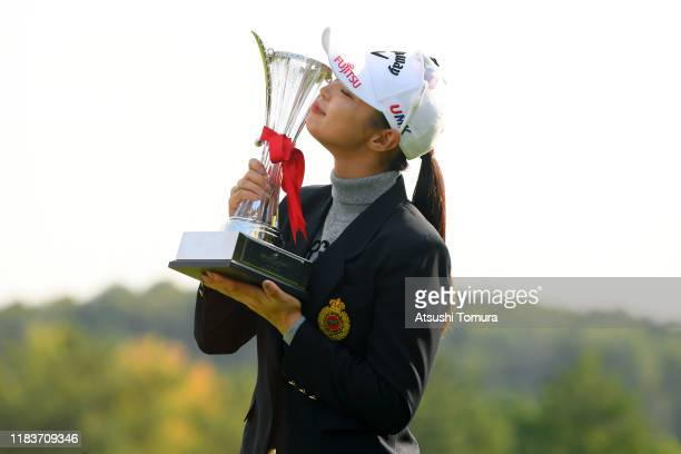 Asuka Kashiwabara of Japan kisses the trophy after winning the tournament at the award ceremony following the final round of the Nobuta Group Masters...