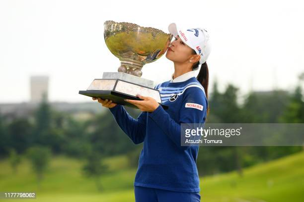 Asuka Kashiwabara of Japan kisses the trophy after winning the tournament following the final round of the Miyagi TV Cup Dunlop Women's Open at Rufu...